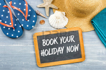 60848529-message-on-a-chalkboard--book-your-holiday-now